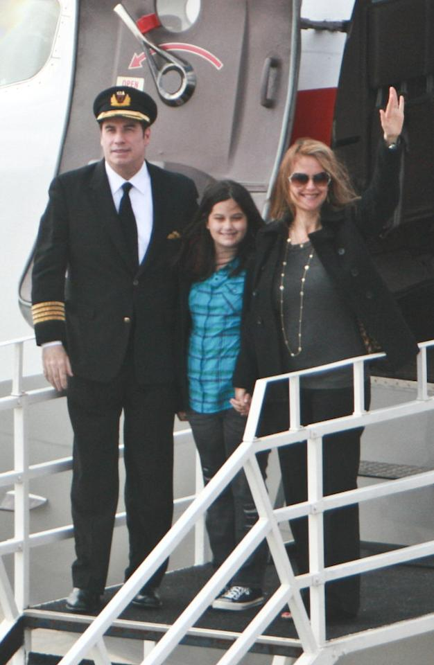 """Doing double duty as a goodwill ambassador for Qantas, John Travolta touched down in Johannesburg, South Africa, with his wife Kelly Preston and their daughter Ella Bleu for the Soccer World Cup Thursday, where 47-year-old Preston was spotted sporting a visible baby bump. Preston's mom Linda Carlson told UsMagazine.com that her daughter's pregnancy was a """"surprise"""" even though they had """"been trying,"""" and that she wasn't worried about complications due to Kelly's age. """"She takes really good care of herself and she's in good health,"""" said Carlson. Sax Rohmer/<a href=""""http://www.splashnewsonline.com"""" target=""""new"""">Splash News</a> - June 10, 2010"""