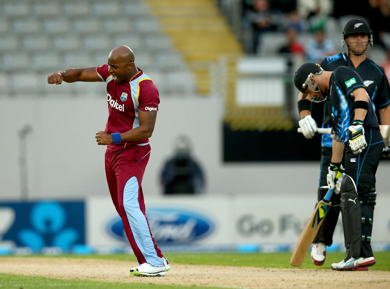 AUCKLAND, NEW ZEALAND - JANUARY 11:  Tino Best of the West Indies celebrates his wicket of Corey Anderson of New Zealand during the first T20 between New Zealand and the West Indies at Eden Park on January 11, 2014 in Auckland, New Zealand.  (Photo by Phil Walter/Getty Images)