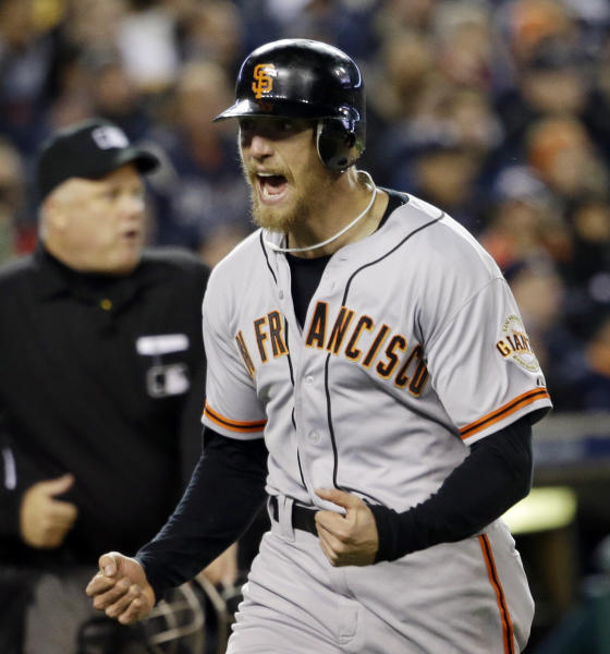 San Francisco Giants' Hunter Pence reacts as he runs home to score a run during the second inning of Game 4 of baseball's World Series against the Detroit Tigers Sunday, Oct. 28, 2012, in Detroit. (AP Photo/David J. Phillip)