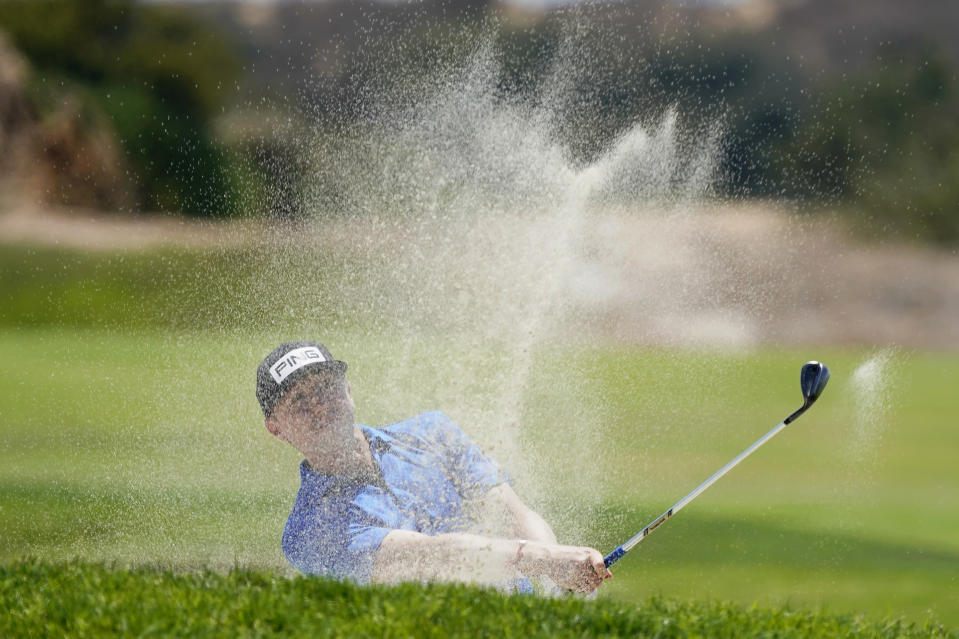 Mackenzie Hughes, of Canada, hits from the 17th fairway during the first round of the U.S. Open Golf Championship, Thursday, June 17, 2021, at Torrey Pines Golf Course in San Diego. (AP Photo/Marcio Jose Sanchez)