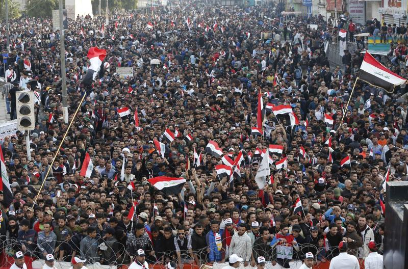 FILE - In this Friday, March 24, 2017 file photo, followers of Shiite cleric Muqtada al-Sadr chant slogans demanding government reform during a demonstration at Tahrir square in Baghdad, Iraq. In early October 2019, social media users began sharing a falsely captioned photo from this event claiming to depict recent protests in Iraq. The country has been embroiled in anti-government clashes for the past week as protesters demand jobs, improved services and an end to corruption. (AP Photo/Karim Kadim)
