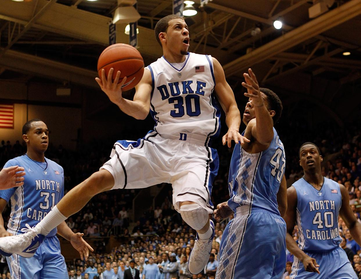 DURHAM, NC - MARCH 03:  Seth Curry #30 of the Duke Blue Devils drives to the basket on James Michael McAdoo #43 of the North Carolina Tar Heels during their game at Cameron Indoor Stadium on March 3, 2012 in Durham, North Carolina.  (Photo by Streeter Lecka/Getty Images)