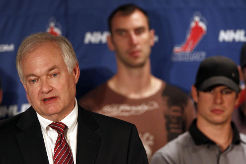 NHL Players Association executive director Donald Fehr, left, is joined by Boston Bruins' Zdeno Chara, center, and Pittsburgh Penguins' Sidney Crosby as he speaks to reporters during a news conference in New York, Thursday, Sept. 13, 2012.  Fehr says a lockout can be avoided and that's up to the league. (AP Photo/Mary Altaffer)