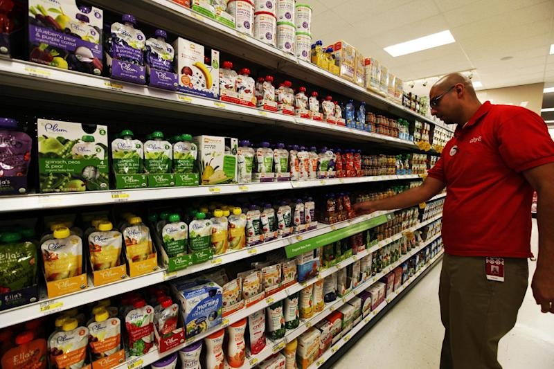 A store employee stocks baby food pouches on the shelf in the baby food aisle in City Target on Thursday, Jan. 3, 2013, in downtown Los Angeles. The popularity of pouches has allowed baby food makers expand the market for their product beyond the traditional baby food years.  (AP Photo/Nick Ut)