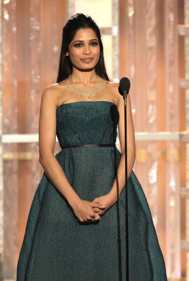 BEVERLY HILLS, CA - JANUARY 15: In this handout photo provided by NBC, actress Freida Pinto presents an award onstage during the 69th Annual Golden Globe Awards at the Beverly Hilton International Ballroom on January 15, 2012 in Beverly Hills, California. (Photo by Paul Drinkwater/NBC via Getty Images)