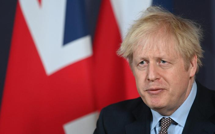Prime Minister Boris Johnson during a media briefing in Downing Street, London, on the agreement of a post-Brexit trade deal - Paul Grover