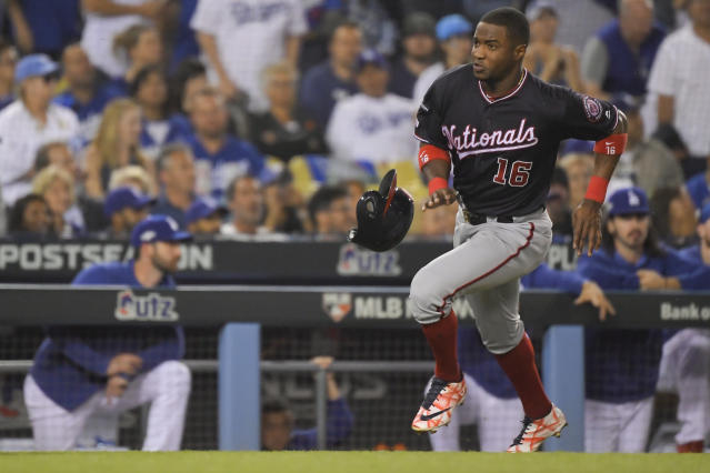 Washington Nationals' Victor Robles scores on a single by Adam Eaton during the second inning in Game 2 of the baseball team's National League Division Series against the Los Angeles Dodgers on Friday, Oct. 4, 2019, in Los Angeles. (AP Photo/Mark J. Terrill)