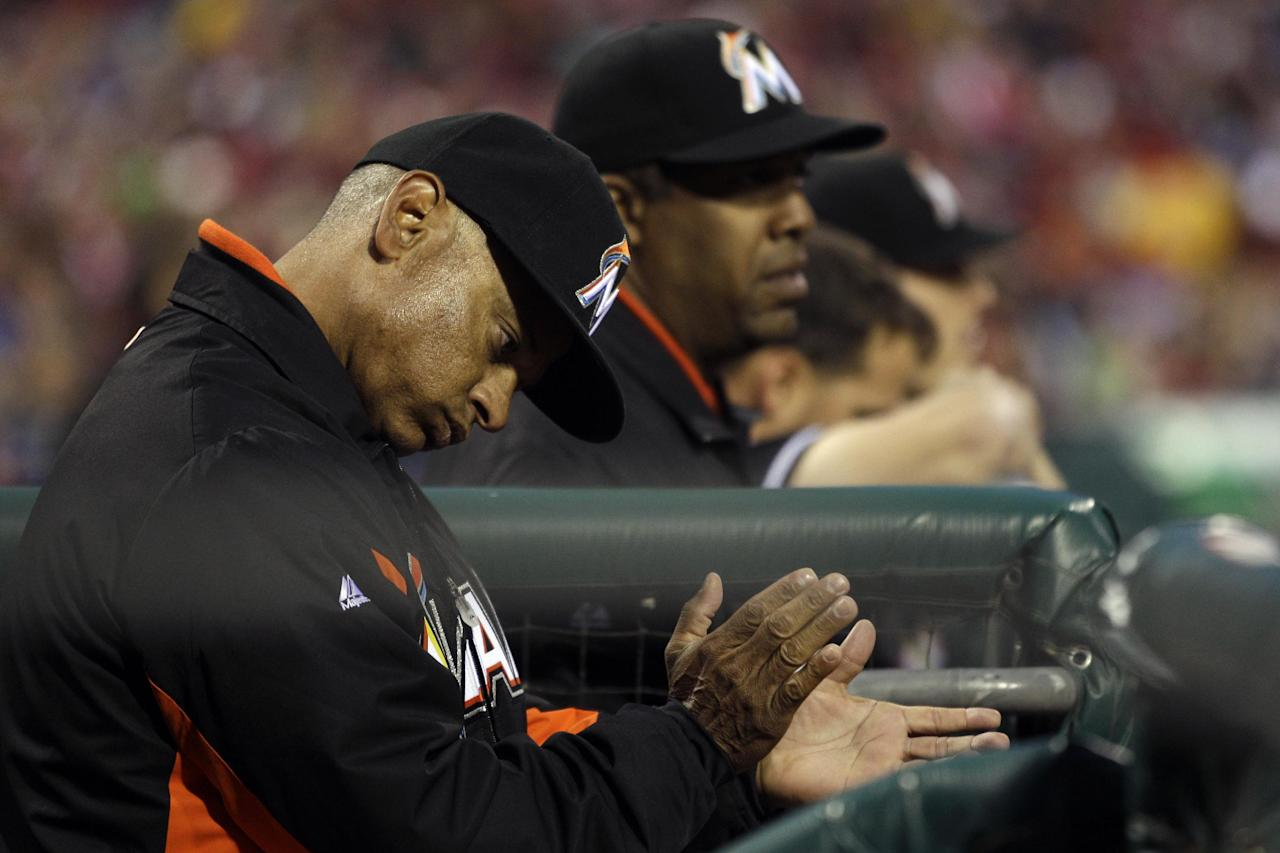 Miami Marlins bench coach Joey Cora cheers during an at-bat in the first inning of a baseball game against the Philadelphia Phillies, Wednesday, April 11, 2012, in Philadelphia. (AP Photo/Matt Slocum)