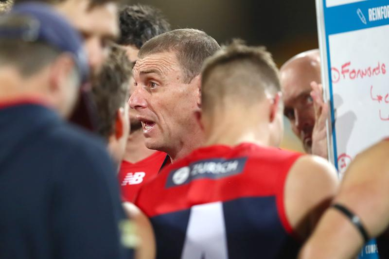Demons coach Simon Goodwin talks to his team during the round nine AFL match between the Melbourne Demons and the Port Adelaide Power.