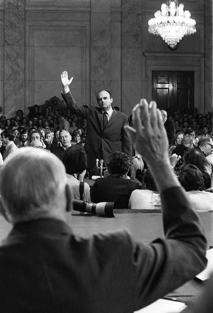 <p>John D. Ehrlichman, Nixon's domestic affairs adviser, is sworn-in by Sen. Sam Ervin, Jr., prior to testifying before the Senate Watergate Committee on July 24, 1973. Ehrlichman was imprisoned for 18 months for his part in the Watergate conspiracy. (Photo: AP) </p>