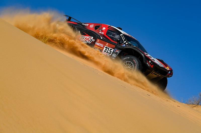 Sainz holds lead as Alonso beaten to stage win