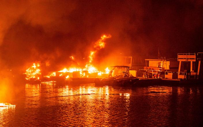 Docked boats burn on Lake Berryessa during the LNU Lightning Complex Fire in Napa, Calif., on Aug. 19.
