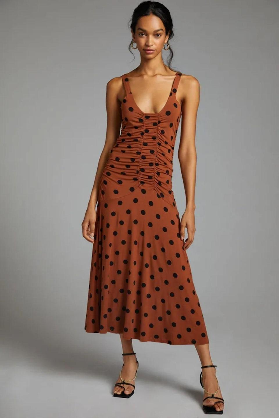 """If your personal style leans casual, try this ruched polka-dot number, which comes in straight, petite, and plus sizes. With the right accessories, you can easily dress it up depending on where the wedding invitation takes you. $160, Anthropologie. <a href=""""https://www.anthropologie.com/shop/maeve-ruched-midi-dress?color=029&type=STANDARD&quantity=1"""" rel=""""nofollow noopener"""" target=""""_blank"""" data-ylk=""""slk:Get it now!"""" class=""""link rapid-noclick-resp"""">Get it now!</a>"""