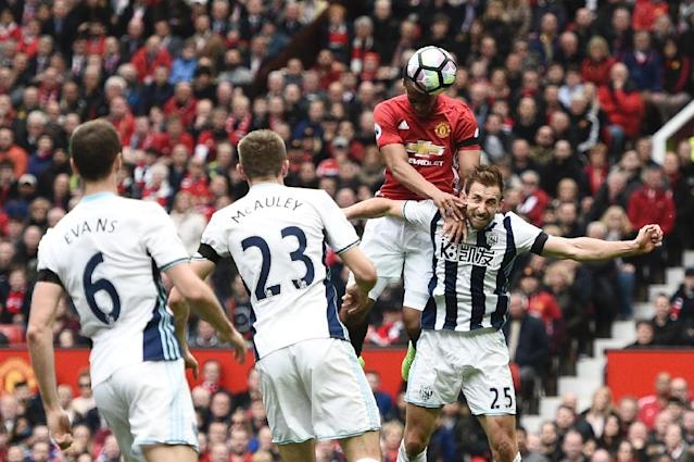 Manchester United's Anthony Martial (2R) climbs above West Bromwich Albion's Craig Dawson (R) but heads wide during their match at Old Trafford on April 1, 2017 (AFP Photo/Oli SCARFF )