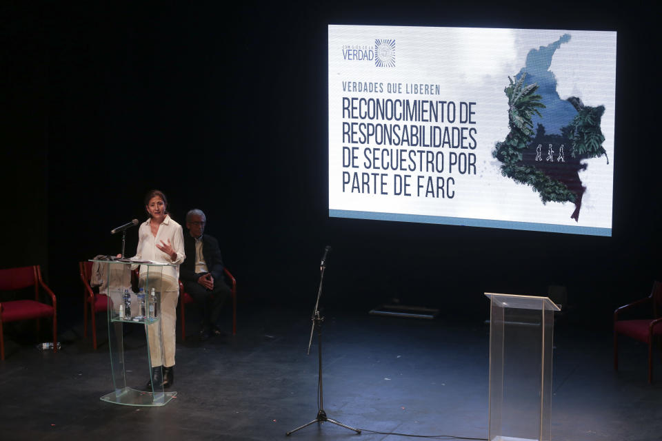 Former Colombian presidential candidate Ingrid Betancourt, who was abducted while campaigning by the Revolutionary Armed Forces of Colombia rebels, speaks during an event at the Truth Commission to commemorate victims of the country's decades-long armed conflict, in Bogota, Colombia, Wednesday, June 23, 2021. (AP Photo/Ivan Valencia)