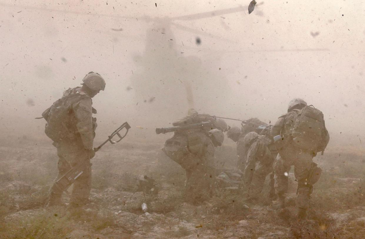 Marines prepare to carry Cpl. Jorge Villarreal of San Antonio, Texas with India Battery, 3rd Battalion, 12th Marine Regiment to a MEDEVAC helicopter near Forward Operating Base (FOB) Zeebrugge on October 17, 2010 in Kajaki, Afghanistan. (Scott Olson/Getty Images)