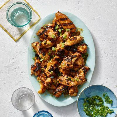 "<p>Everyone's favorite party appetizer can take center stage at family dinner, too. These wings, complete with their smoky char and tossed in a bourbon-apricot barbecue sauce, will be a serious star on your table tonight.</p><p><em><a href=""https://www.goodhousekeeping.com/food-recipes/a31914016/grilled-chicken-wings-recipe/"" rel=""nofollow noopener"" target=""_blank"" data-ylk=""slk:Get the recipe for Grilled Chicken Wings »"" class=""link rapid-noclick-resp"">Get the recipe for Grilled Chicken Wings »</a></em></p><p><strong>RELATED: </strong><a href=""https://www.goodhousekeeping.com/food-recipes/easy/g122/easy-appetizers/"" rel=""nofollow noopener"" target=""_blank"" data-ylk=""slk:51 Easy Appetizers and Snacks to Get the Party Started"" class=""link rapid-noclick-resp"">51 Easy Appetizers and Snacks to Get the Party Started</a></p>"