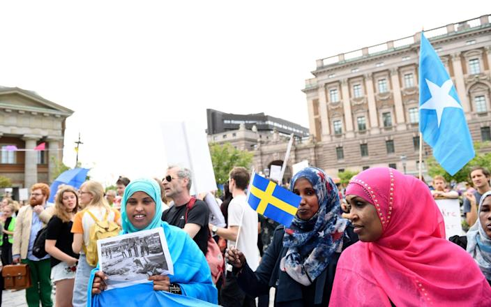 Protesters gather outside parliament in 2016 to demonstrate against tougher new asylum policies - AP