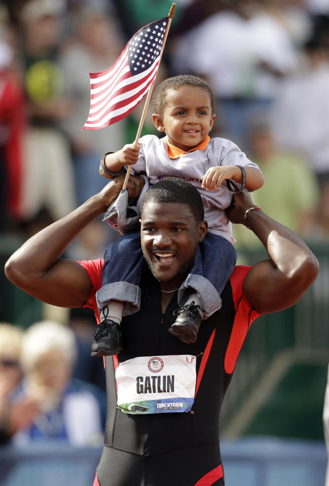 Justin Gatlin celebrates with his son Jace after winning the men's 100m finals at the U.S. Olympic Track and Field Trials Sunday, June 24, 2012, in Eugene, Ore. (AP Photo/Marcio Jose Sanchez)