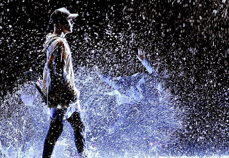 Singer Justin Bieber, photographed in a water-soaked performance at the American Music Awards on November 22, 2015, may need a little more liquid assistance: the City of San Francisco has ordered his publicists to clean up a street-art PR campaign