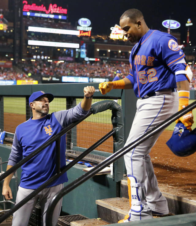 "FILE - In this April 24, 2018, file photo, New York Mets' Yoenis Cespedes (52) is congratulated by manager Mickey Callaway after hitting a three-run home run during the fifth inning of a baseball game against the St. Louis Cardinals in St. Louis. The slumping Mets have announced they are sticking with embattled manager Callaway ""for the foreseeable future"" _ and sidelined slugger Cespedes broke his right ankle in an accident on his ranch. (AP Photo/Jeff Roberson, File)"