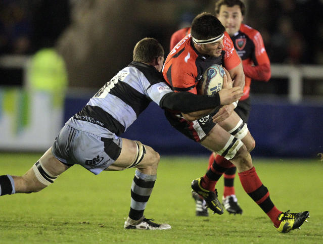 Newcastle Falcons' Mark Wilson (L) tackles Toulon's Christophe Samson (R) during a pool 2, European Challenge Cup rugby union match at Kingston Park, Newcastle upon Tyne, England, on December 8, 2011. AFP PHOTO/GRAHAM STUART (Photo credit should read GRAHAM STUART/AFP/Getty Images)