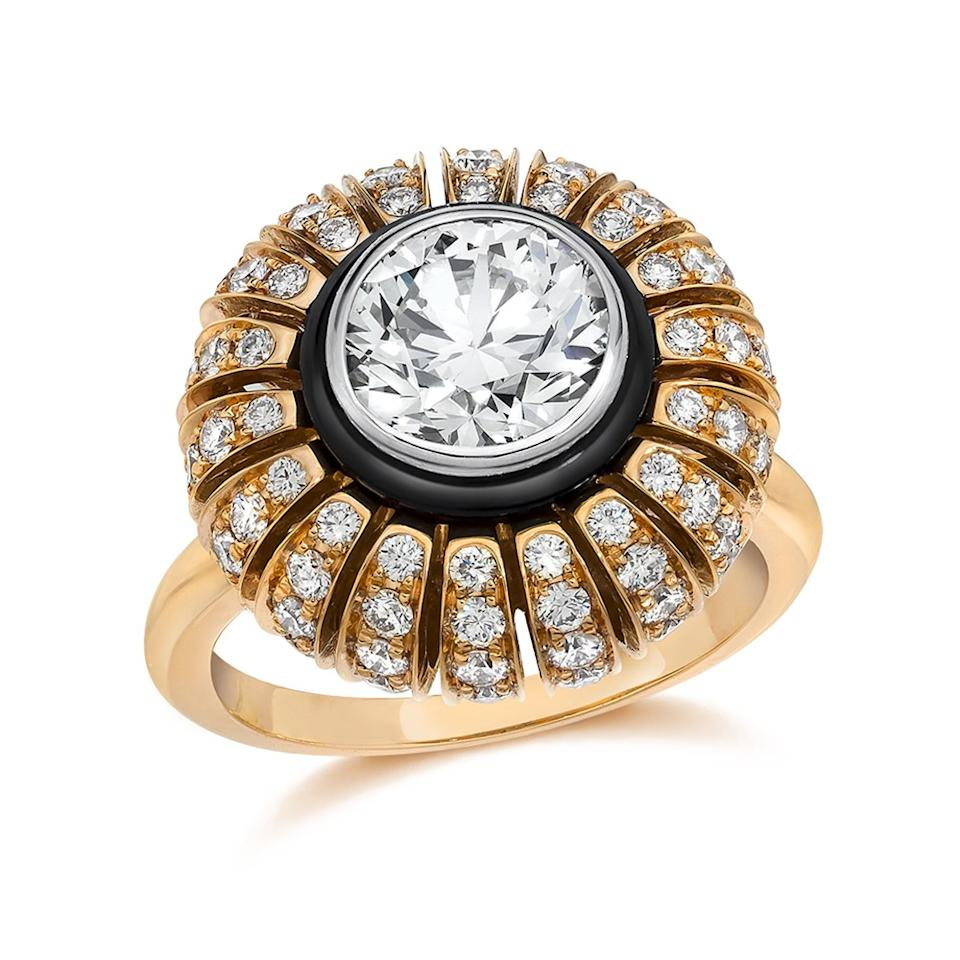 """Inspired by the sun and stars, this handcrafted ring has an almost heavenly glow. The sparkling center stone is accented by an ornate rose gold, diamond and black onyx halo setting. (""""Plume"""" rose gold diamond ring, $15,000, Golkonda)"""