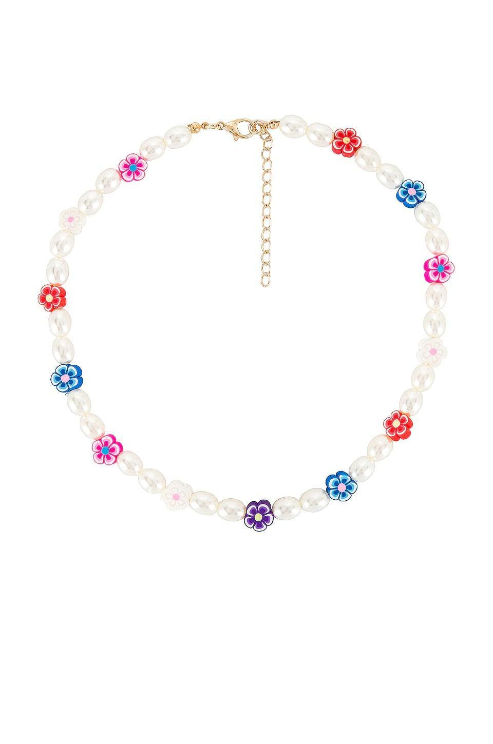 <p><span>petit moments Daisy Pearl Necklace in Gold</span> ($35)</p>