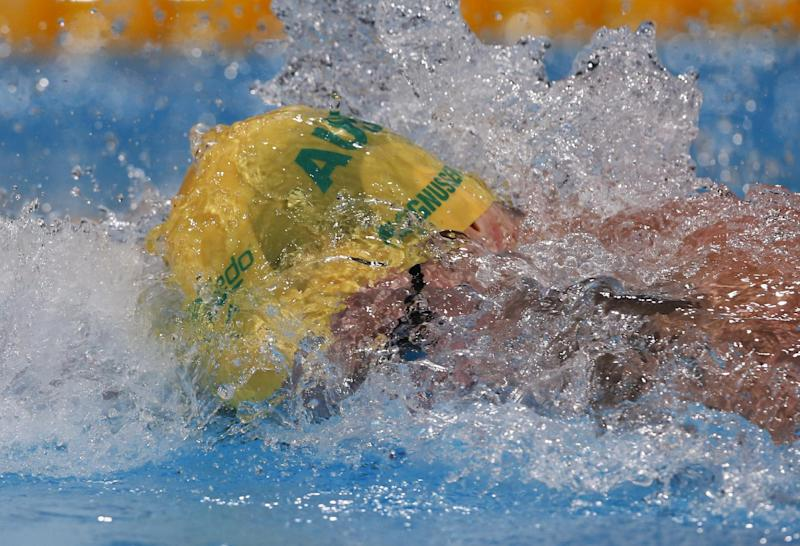 Australia's James Magnussen swims in a Men's 100m freestyle heat at the FINA Swimming World Championships in Barcelona, Spain, Wednesday, July 31, 2013. (AP Photo/Michael Sohn)