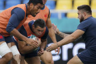 From left France's Sebastien Vahaamahina, Guilhem Guirado, and Cyril Baille practise during a training session in Fukuoka, southwestern Japan, Tuesday, Oct. 1, 2019. France will plays tomorrow against USA during their Rugby World Cup Pool C game. (AP Photo/Christophe Ena)