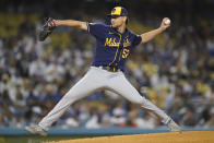 Milwaukee Brewers starting pitcher Eric Lauer (52) throws during the first inning of a baseball game against the Los Angeles Dodgers Friday, Sept. 1, 2021, in Los Angeles. (AP Photo/Ashley Landis)