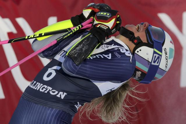 Italy's Marta Bassino celebrates in the finish area after winning an alpine ski, women's World Cup giant slalom in Killington, Vt., Saturday, Nov. 30, 2019. (AP Photo/Charles Krupa)