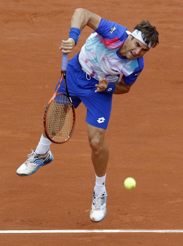 Spain's David Ferrer serves the ball to Italy's Simone Bolelli during their second round match of the French Open tennis tournament at the Roland Garros stadium, in Paris, France, Thursday, May 29, 2014. (AP Photo/Michel Euler)