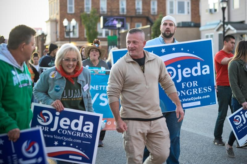 Democratic congressional candidate Richard Ojeda of West Virginia, seen here marching in a homecoming parade in Huntington, is a tough-talking military veteran who is seeking to win a district that voted overwhelmingly for Donald Trump in 2016 (AFP Photo/Michael Mathes)