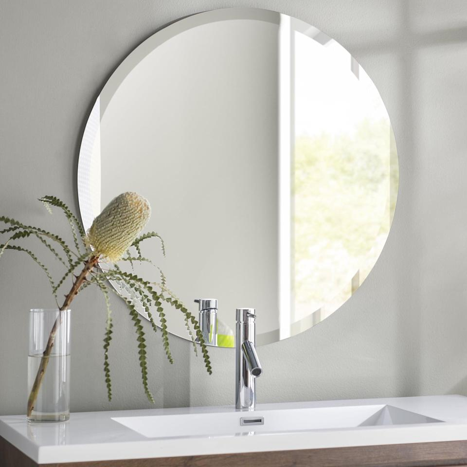 <p>If you're not a fan of framed mirrors, the <span>Valdosta Modern and Contemporary Beveled Frameless Vanity Mirror</span> ($73) is a great wall-mounted option.</p>