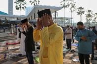 Muslims pray outside the closed National Mosque while celebrating Eid al-Fitr, the Muslim festival marking the end the holy fasting month of Ramadan, amid the coronavirus disease (COVID-19) outbreak in Kuala Lumpur