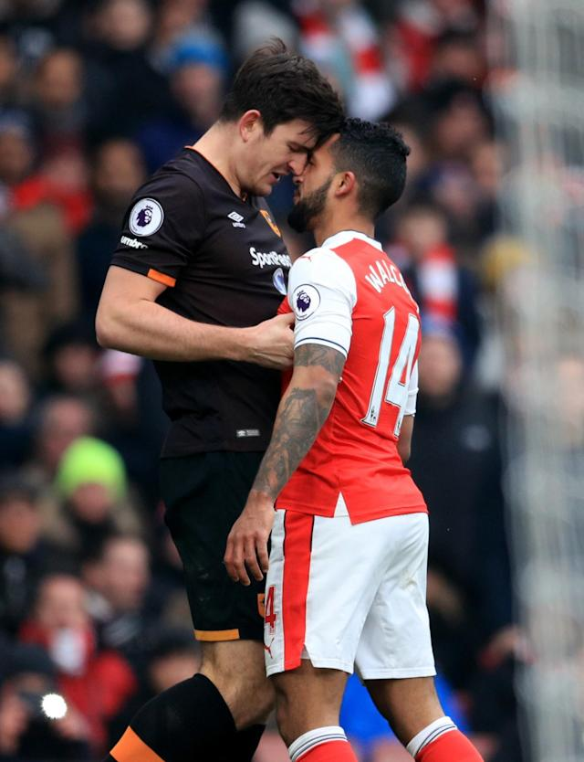 <p>Theo Walcott squares up to Hull's Harry Maguire</p>