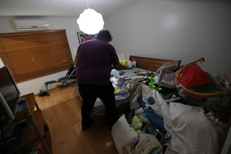Personal belongings are seen on the floor and over a bed at the residence of Roberto Marrero, former chief of staff to opposition leader Juan Guaido, after he was detained in Caracas