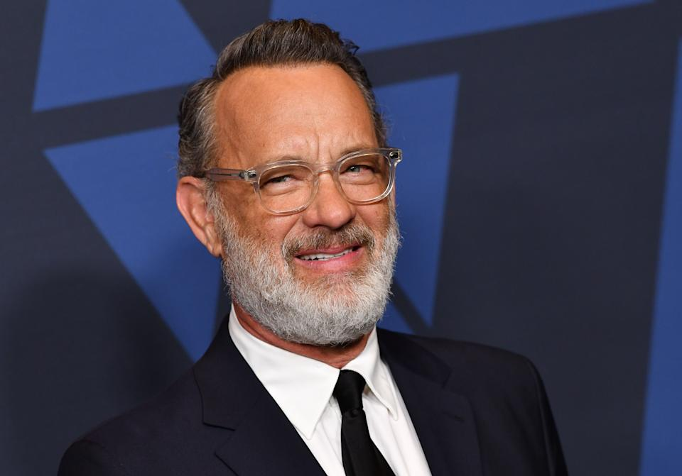 Tom Hanks addresses his COVID-19 battle — and the U.S. response to the pandemic — in a new interview. (Photo: Chris Delmas / AFP) (Photo by CHRIS DELMAS/AFP via Getty Images)