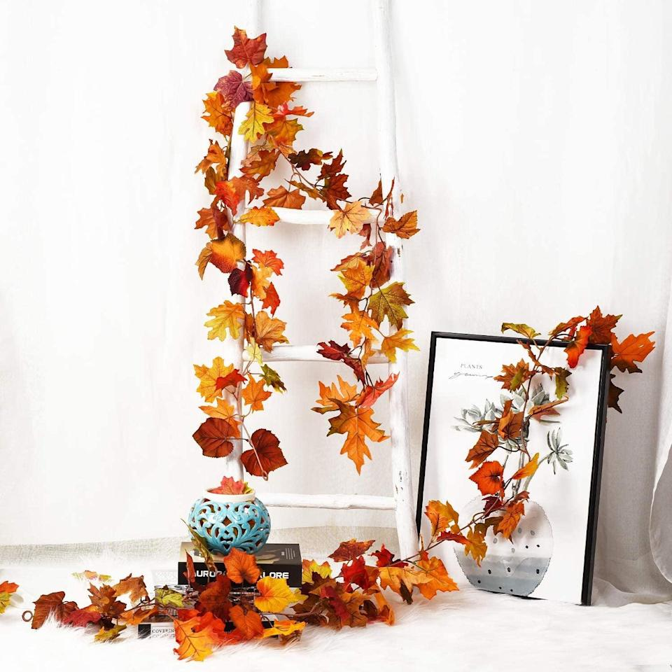<p>Hang this <span>DearHouse 2 Pack Fall Garland</span> ($20) on your mantel.</p>
