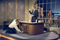 <p>Bill Murray spray paints Dave's desk on the first taping of the Late Show with David Letterman, August 30, 1993.</p>