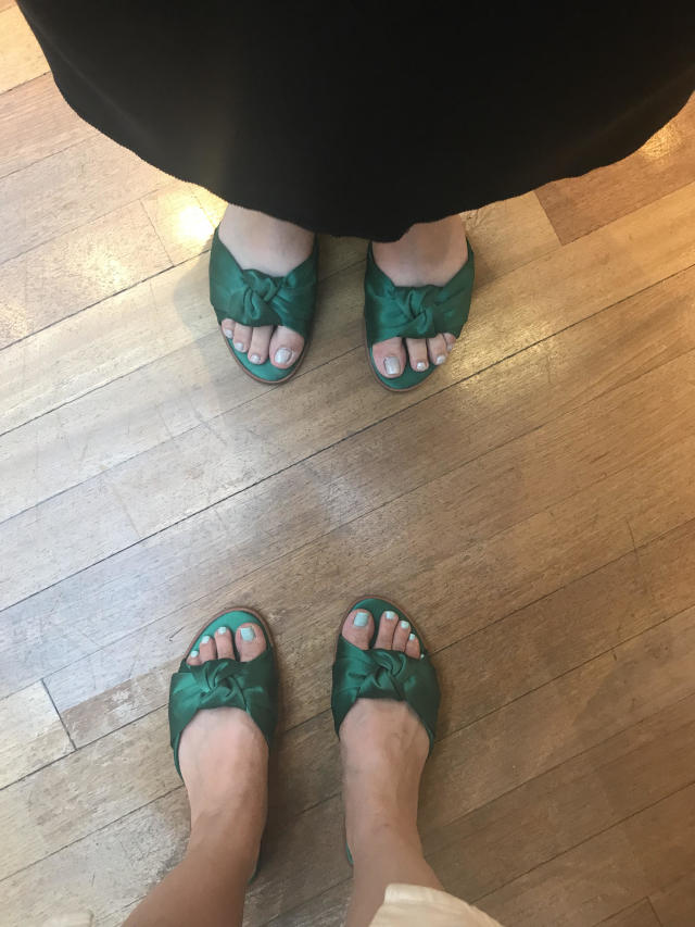 Fashion editor Julie Tong and an unidentified fashion publicist wearing Target's A New Day Stacia knotted satin slide sandals in green. (Photo: Julie Tong)