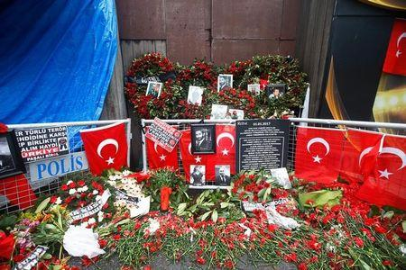 Flowers and pictures of the victims are placed near the entrance of Reina nightclub in Istanbul, Turkey, January 17, 2017. REUTERS/Osman Orsal/File Photo