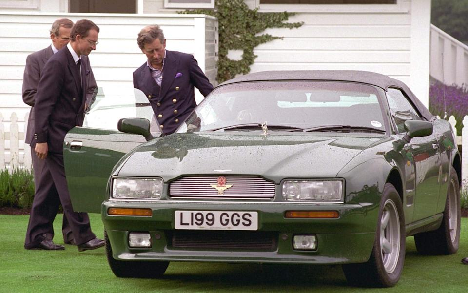 Prince Charles gets into his 1986 Aston Martin V8 Vantage Volante after playing polo at Windsor - Tim Graham