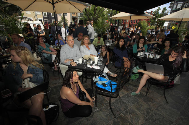 <p>Bill Daggett, center left, and his wife Kathy Daggett, center, right, watch a live television broadcast of former FBI director James Comey testifying before the Senate Select Committee on Intelligence, on Capitol Hill, with a group of other people at Shaw's Tavern in Washington, June 8, 2017. (Manuel Balce Ceneta/AP) </p>