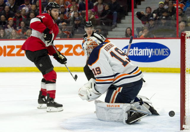 Ottawa Senators center Chris Tierney (71) watches his shot go wide of the net past Edmonton Oilers goaltender Mikko Koskinen during the second period of an NHL hockey game Thursday, Feb. 28, 2019, in Ottawa, Ontario. (Adrian Wyld/The Canadian Press via AP)