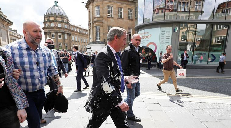 Nigel Farage, farage milkshake thrown video, Nigel Farage milkshake attack, milkshake thrown at politicians, EU elections, european parliament elections, newcastle farage campaign, viral videos