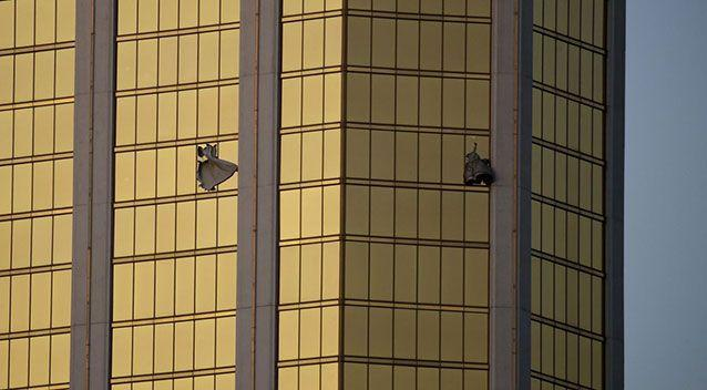 Drapes billow from two broken windows at the Mandalay Bay Resort and Casino on the Las Vegas Strip on Oct. 2, 2017. Source: John Locher/AP