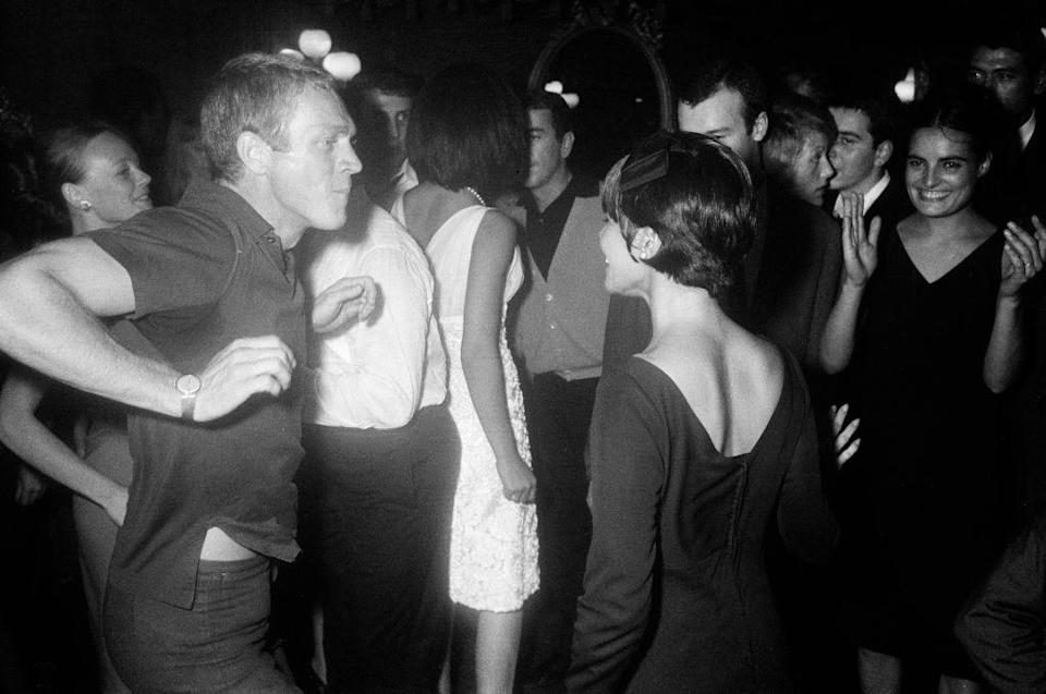 """<p>""""The King of Cool"""" gets his groove on in Paris jazz club, Le Bilboquet. His dance partner for the night was his first wife, actress Neile Adams.</p>"""
