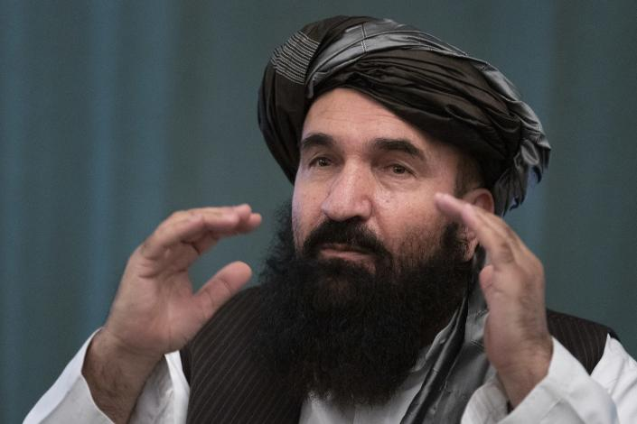 """Khairullah Khairkhwa, former western Herat Governor and one of five Taliban released from the U.S. prison on Guantanamo Bay in exchange for U.S. soldier Bowe Bergdahl, gestures during a joint news conference in Moscow, Russia, Friday, March 19, 2021. The Taliban warned Washington against defying a May 1 deadline for the withdrawal of American and NATO troops from Afghanistan, and promising a """"reaction,"""" if the deadline is not met. (AP Photo/Alexander Zemlianichenko, Pool)"""